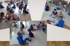 Dzieci-siedzac-na-podlodze-maluja-obraz-martwej-natury