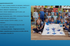 1-Zdjecie-grupowe-dzieci-siedzac-trzymaja-wykonane-zadanie