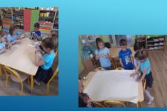 2-Kilkoro-dzieci-wycina-i-przykleja-haslo-Jestesmy-z-Wami-niebieskimi-motylami