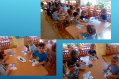 Dzieci-grupy-III-maluja-motyle-niebieska-farba-za-pomoca-palca